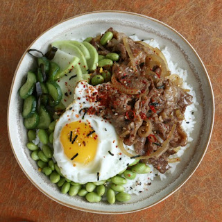 Beef And Onion Donburi With Edamame And Fried Egg