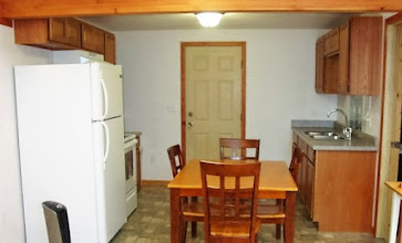 Photo: Cabin 7 inside kitchen view.  Full bathroom is door on the right.