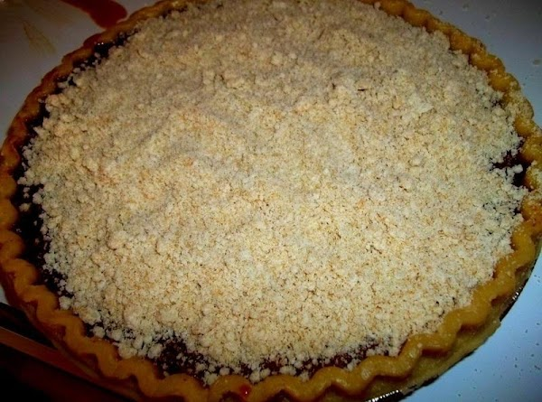 Pour filling into the shell and sprinkle the crumb mixture over the top.