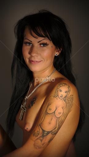 Nude boob women tattoo