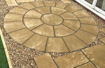 a patio design with brick tiles in a circle