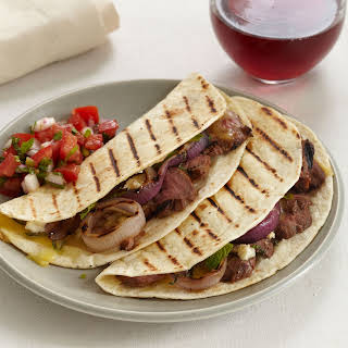 Grilled Lamb and Red Onion Tacos with Tomato-Mint Salsa.