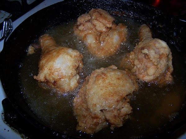 Fry 4-5 pieces of chicken in hot shortening for approximately 10-12 minutes on one...