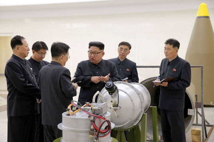 North Korean leader Kim Jong Un provides guidance with Ri Hong Sop (3rd L) and Hong Sung Mu (L) on a nuclear weapons programme in this undated photo released by North Korea's Korean Central News Agency (KCNA) in Pyongyang September 3, 2017.