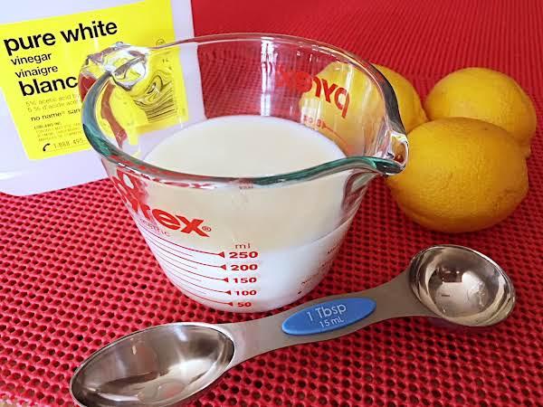 Measuring Spoon, Measuring Cup, Milk, Vinegar And Lemons.