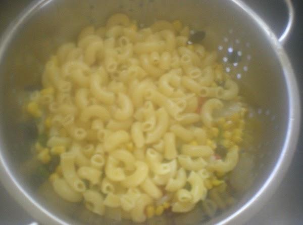 Pour over veggies in colander.
