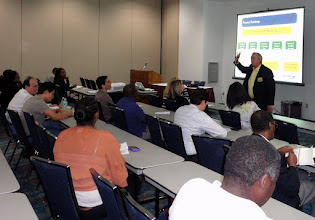 Photo: Broward SCORE Chairman Eric Thompson leading the workshop on Starting Your Own Business at Congresswoman Debbie Wasserman Scultz's Annual Small Business Workshop