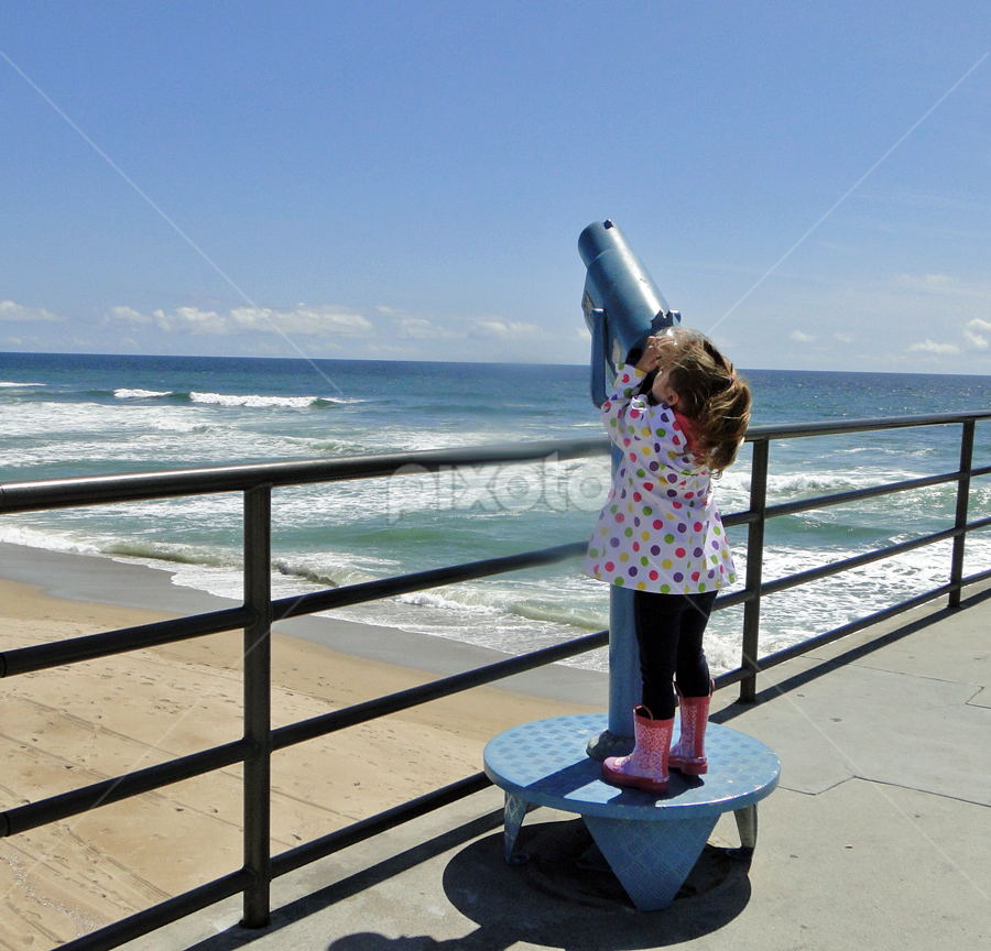 by Liz Rosas - Babies & Children Children Candids ( rain coat, blonde, little girl, polka-dot, pier, pink, telescope, huntington beach, boots )