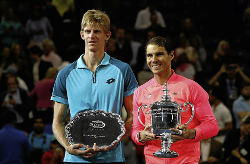 Rise in rankings: Rafael Nadal, right, with the US Open trophy and South African runner-up Kevin Anderson pose in New York. Picture: REUTERS