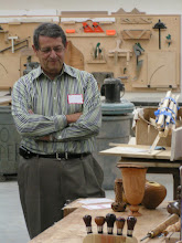 Photo: Jerry looks at Clif Poodry's natural-edge vase on the table.  That's Jerry's hollow form there too, behind it.