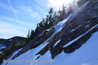 Photo: NP climbing up the continuation of the center route up the slide after our exploration to the north.