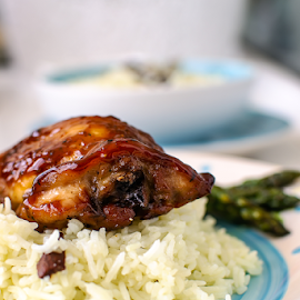 Teriyaki chicken drumsticks by Yancho Zapryanov - Food & Drink Plated Food ( scallions, chicken, lunch, green, tablecloth, seeds, teriyaki, chopsticks, asian, sauce, rice, bowl, brown, dinner, food, drumstick, cardamom, white, background, wooden, sesame, asparagus, table )