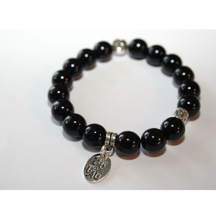 Armband av svart glas och metall