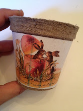 Photo: I started with a small peat pot, but you can also use a paper cup.  I used a glue stick to attach a vintage Easter image that I printed out from my computer.