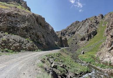 Road squeezes through a narrow gorge.