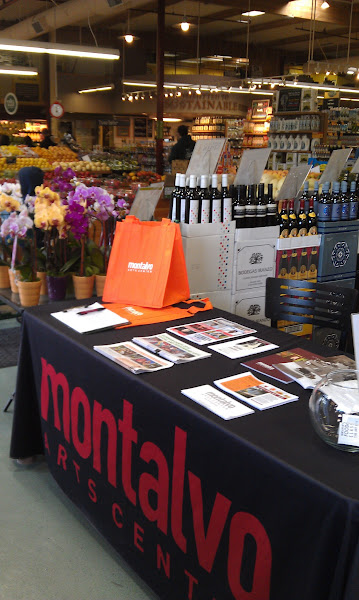 Photo: Our table at Whole Foods Market Los Gatos, set up for 5% Day. (Photo by Michele Isaac) Week of May 4, 2012.