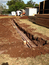 Photo: Laying out copper pipes -- I think this is going to the portables and the new buildings