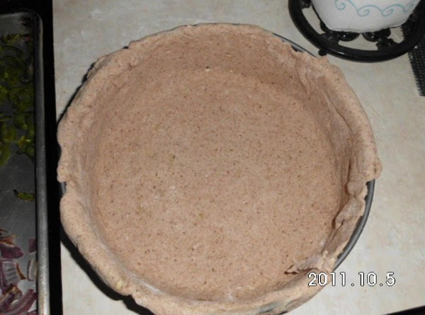 Spray bottom and sides of a tart pan.  Place dough over pan and...