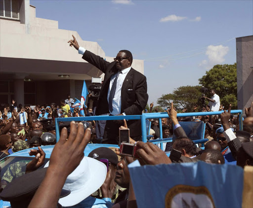 Malawi's President Peter Mutharika of the Democratic Progressive Party waves to supporters after he was sworn in in Blantyre. Photo: REUTERS