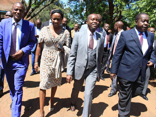 Education CS Fred Matiang'i (R) with ICT CS Joe Mucheru and TSC CEO Nancy Macharia arrive at Nairobi School to release the Kenya Certificate of Secondary Education Exam results 2017 on December 20. / EZEKIEL AMINGÁ