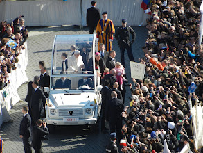 Photo: Babies being passed to the Holy Father who blessed and kissed them