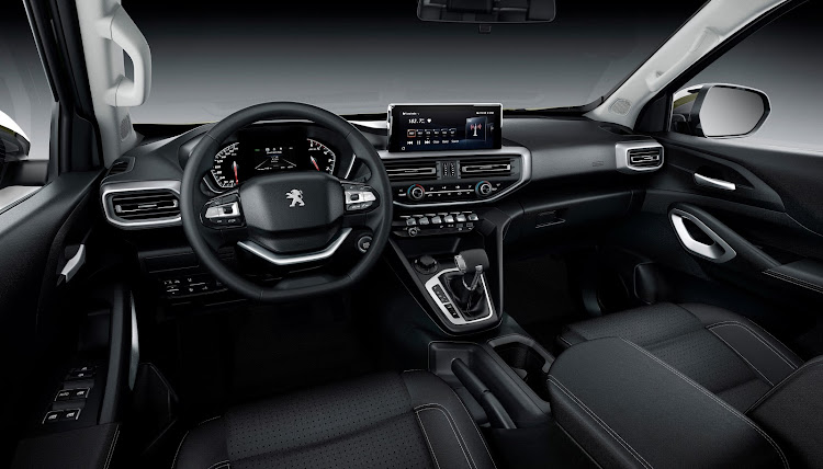 The modern interior has a two-spoke steering wheel and a high definition infotainment system.
