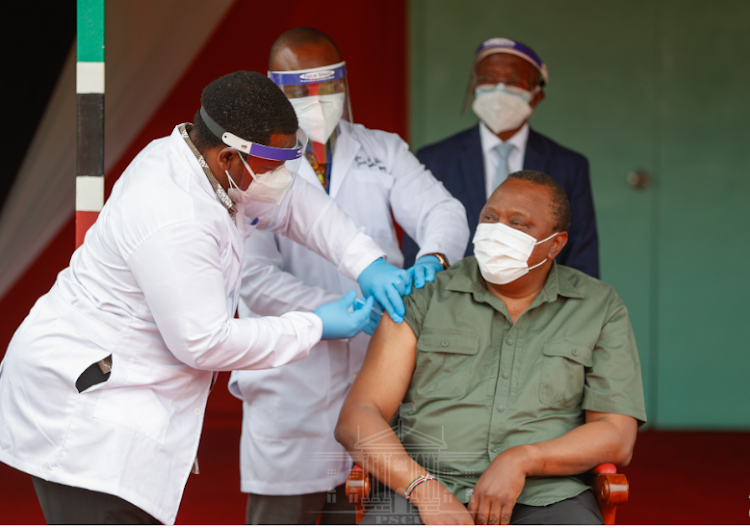 President Uhuru Kenyatta is vaccinated at State House, Nairobi, on March 26, 2021.