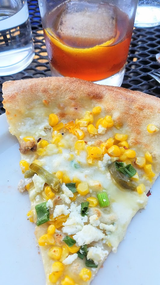 Ken's Artisan Pizza, 12 inch thin crust perfection, this one is the seasonal Fresh corn with corn, mozzarella, ricota salata, smoked pickled jalapenos, scallions and the Ken's Old Fashioned with Evan Williams, Ramazotti Amaro, demerara sugar, Angostura bitters, and orange skin