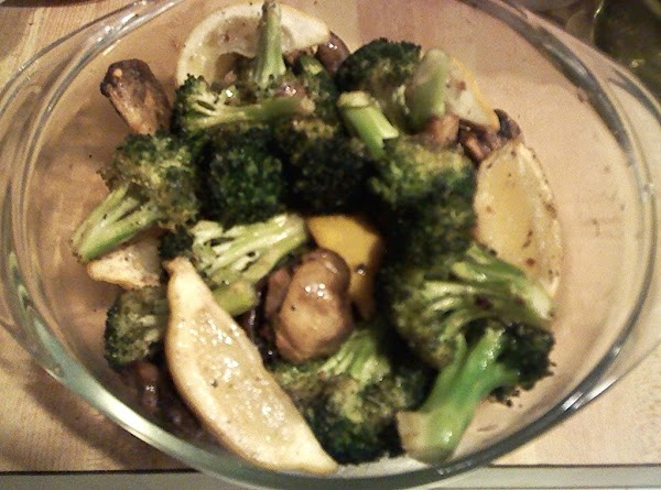 Place in serving bowl and squeeze 2-4 of the lemon slices over the broccoli...