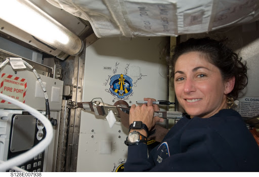 Stott signs crew patch in Joint Airlock