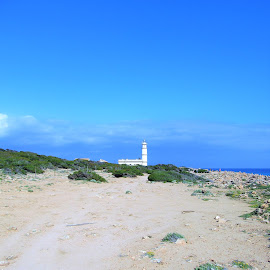 The beach and one of the lighthouses on Mallorca by Svetlana Saenkova - Landscapes Beaches ( horizon, blue sky, white lighthouse, lighthouse, sandy, travel, summer )
