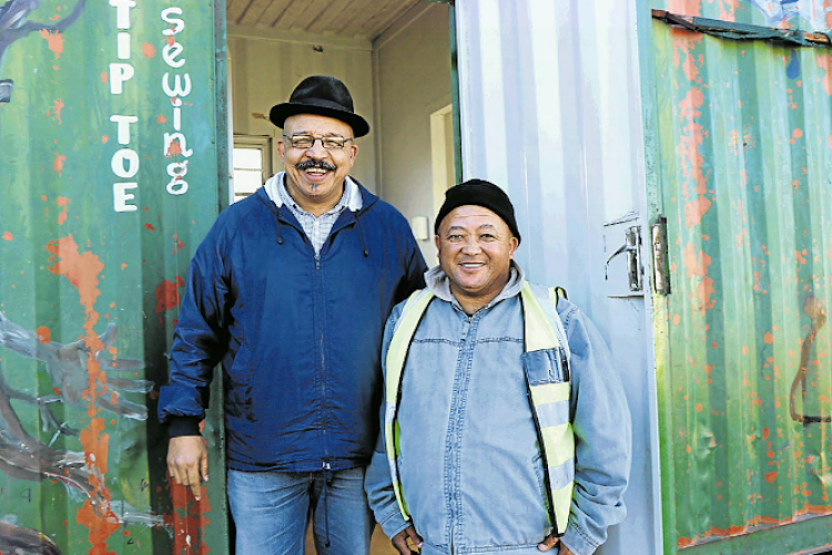 Mark Stewart and Nathan Miles outside the New Kwanda Pefferville container where maths classes take place