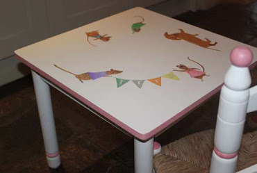 a white and pink children's table with mouse on