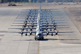 Photo: A line of C-130 Hercules taxi during a Mobility Air Forces Exercise on Nov. 18, 2009, at Nellis Air Force Base, Nev. Approximately 40 C-17 Globemaster IIIs and C-130s from Air Force bases around the U. S. flew about 400 Soldiers from Fort Bragg, N.C., for airdrops on the Nevada Test and Training Range. (U.S. Air Force photo/Airman 1st Class Stephanie Rubi)