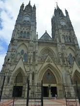Photo: Facade of the Basilica del Voto Nacional, rebuilt in the 1920s. Both towers have clocks.