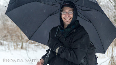 Photo: Steve grinning for the camera.  He had brought an umbrella with him cause he didn't want to get his camera wet as it wasn't waterproof. :)
