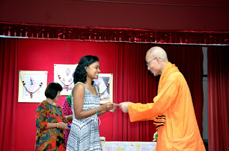 Photo: Mirnalini Dirghar who has done well in A level receiving the Award from Swami Satyalokananda