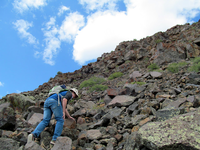 Bradley climbing the field of rocks