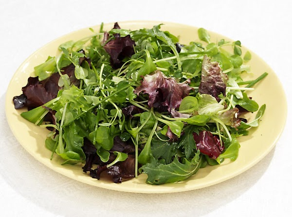 Place the salad in the center of the plate and arrange the brie around...