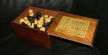 Photo: A Tuff-A-Nuff set in the collection of Jon Crumiller, K=3.25in, unweighted: see -  http://www.crumiller.com/chess/chess_pages/staunton/JaquesTuffANuffRubberSet.htm  Interesting points to note:  i) Jon's set has a crown-stamp clearly visible on the knight and rook at the right of the box. There is no sign on any of my pieces of such a stamp.  ii) it is in a slide-lid box, as opposed to my lidded/hooked box.