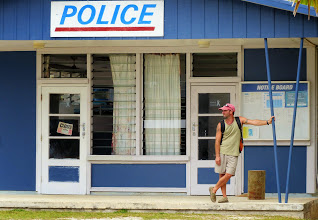 Photo: Brian is waiting to get his local driver's license -the police station is closed for lunch.  Not surprising that even crime would be civilized enough to break for lunch on this chill, friendly little island!