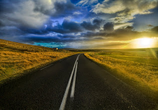 Photo: The Open Road in Iceland   I had a long lonely weekend in Iceland, so I took my rental Jeep out into the wild. I drove all over the country from dawn till dusk seeing what I could find. The sky and landscape was an ever changing palette of colors and clouds.  The sun is so low on the horizon during the winter that it is almost like a 5-hour sunrise followed by a 5-hour sunset. I drove up and down one of these highways to the next, listening to all kinds of strange and eclectic music on my iPod, occasionally jumping out to take a shot of something like this... it was a perfect weekend.  From Trey Ratcliff at stuckincustoms.com