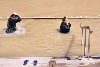 Photo: Baptism at the Palestinian side of the river