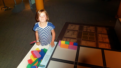 Photo: Gen, building with blocks in the Skyscrapers! exhibit.
