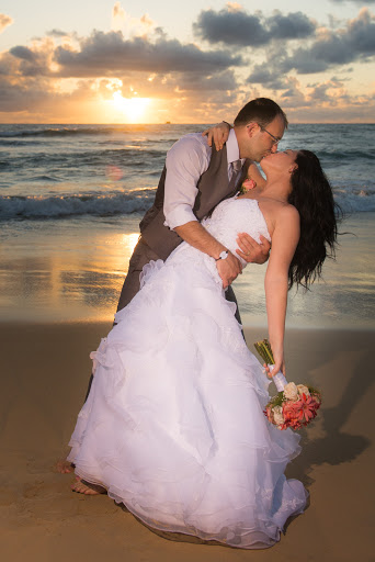 A newlywed couple on the beach in Punta Cana, Dominican Republic, at daybreak.
