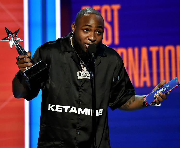 Davido accepts the Best International Act award onstage at the 2018 BET Awards at Microsoft Theater