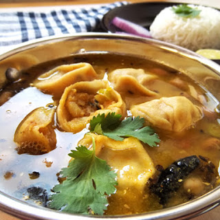 Mashed Potato Dumplings With Lentil Curry.
