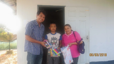 Photo: Phidthaya receives gifts donated by Connie Low from Singapore, with Gee and Kanda