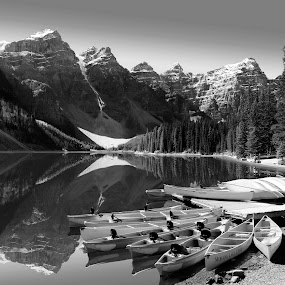 Moraine Lake in Black and White by Gerry Slabaugh - Black & White Landscapes ( hill, reflection, mountain, canadian rockies, black and white, banff national park, canoe, rockies, lake, glacial, landscape, moraine lake,  )