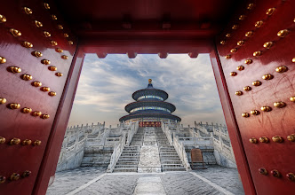 Photo: Gateway to the Temple of Heaven  I had an amazing opportunity in Beijing to get private access into the Temple of Heaven one morning.  Well-costumed officials from the government met me before sunrise just outside the gates, where hundreds of early risers were already outside doing exercises and preparing for a national holiday.  The nice men pulled out ornate keys and opened up the private doors to let me in.  I had about 90 minutes to take photos of everything as the sun rose.  It was a great day of shooting!  from the blog www.stuckincustoms.com